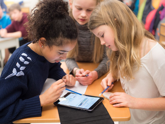 Image of students using iPad